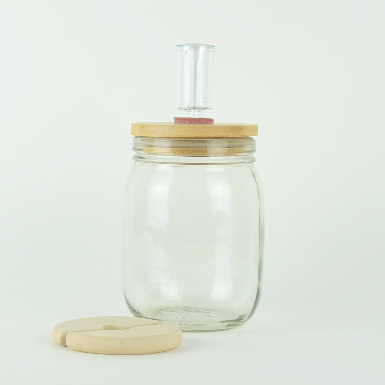 Glass fermentation jar sets with ceramic weights, wooden lids and brewing airlocks. For making sauerkraut and kimchi.